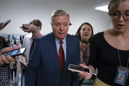 (AP Photo/J. Scott Applewhite). IN this March 13, 2019, photo, reporters pose questions to Sen. Lindsey Graham, R-S.C., at the Capitol in Washington, Wednesday, March 13, 2019. The Republican-led Senate is set to deal President Donald Trump a rebuke on...