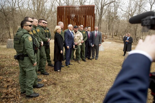 (AP Photo/Andrew Harnik). A section of border wall, used for training, is visible behind Vice President Mike Pence, center, and Homeland Security Secretary Kirstjen Nielsen, center left, as they pose for a photograph with Border Patrol agents following...