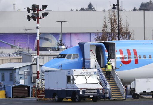 (AP Photo/Ted S. Warren). A worker walks up steps to the right of an avionics truck parked next to a Boeing 737 MAX 8 airplane being built for TUI Group at Boeing Co.'s Renton Assembly Plant Wednesday, March 13, 2019, in Renton, Wash. President Donald ...