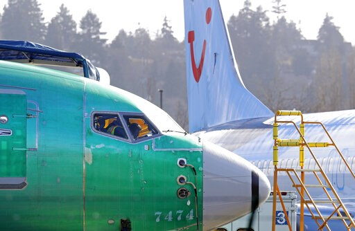 (AP Photo/Ted S. Warren). People work in the flight deck of a Boeing 737 MAX 8 airplane being built for TUI Group parked next to another MAX 8 also designated for TUI at Boeing Co.'s Renton Assembly Plant Wednesday, March 13, 2019, in Renton, Wash. Pre...