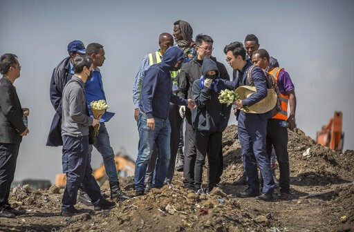 (AP Photo/Mulugeta Ayene). Chinese relatives of victims who died in the crash visit and grieve at the scene where the Ethiopian Airlines Boeing 737 Max 8 crashed shortly after takeoff on Sunday killing all 157 on board, near Bishoftu, or Debre Zeit, so...