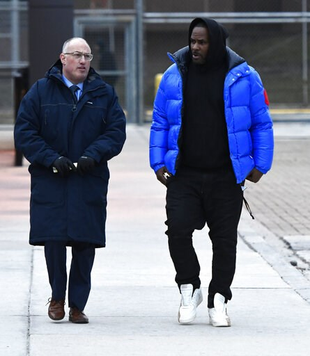 (AP Photo/Matt Marton, File). FILE - In this Monday, Feb. 25, 2019 file photo, R. Kelly, right, leaves Cook County Jail with his defense attorney, Steve Greenberg, in Chicago. Sex videos like those that have been integral to the criminal cases against ...