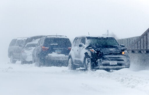 (AP Photo/David Zalubowski). A string of wrecked vehicles sit on an overpass over Interstate 70 as a late winter storm packing hurricane-force winds and snow sweeps over the intermountain West Wednesday, March 13, 2019, in Aurora, Colo.