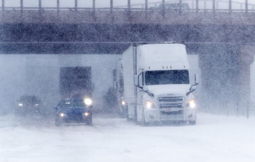 (AP Photo/David Zalubowski). Traffic stops in the eastbound lanes of Interstate 70 near Tower Road as a late winter storm packing hurricane-force winds and snow sweeps over the intermountain West Wednesday, March 13, 2019, in Auora, Colo.