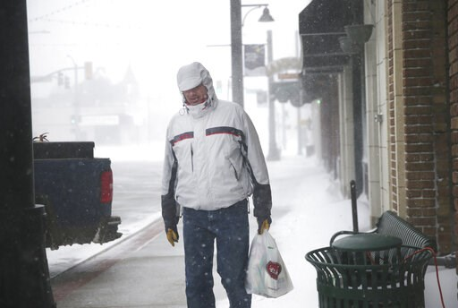 (Jacob Byk/The Wyoming Tribune Eagle via AP). A man walks along 17th Street during a blizzard on Wednesday, March 13, 2019, in Cheyenne. White-out conditions closed I-80, I-25, and U.S. 85, effectively closing off the state capital from Nebraska, Color...