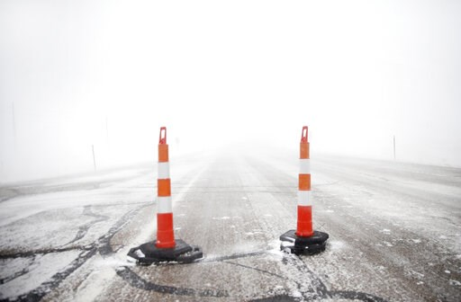 (Jacob Byk/The Wyoming Tribune Eagle via AP). Cones block travel on Happy Jack Road during a blizzard on Wednesday, March 13, 2019, in Cheyenne, Wyo. White-out conditions closed I-80, I-25, and U.S. 85, effectively closing off the state capital from Ne...