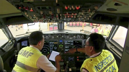 (AP Photo). In this image from video taken on Tuesday, March 12, 2019, officials make inspection inside the cockpit of a Boeing 737 Max 8 aircraft is in hangar  at Garuda Maintenance Facility at Soekarno Hatta airport, Jakarta. The Indonesian Transport...