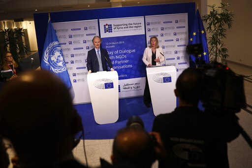 (AP Photo/Francisco Seco). European Union foreign policy chief Federica Mogherini, right, and UN Syria envoy Geir Pedersen talk to journalists at the European Parliament on the eve of the Syria donors conference, in Brussels, Wednesday, March 13, 2019....