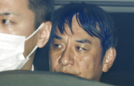 """(Takuya Inaba/Kyodo News via AP). In this March 14, 2019, photo, Japanese musician Pierre Taki in a police car is sent to a prosecutor's office in Tokyo. Japanese entertainment company Sega has cancelled shipments of its video game """"Judgment,"""" also kno..."""