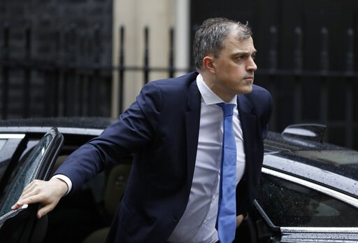 (AP Photo/Kirsty Wigglesworth). Britain's Chief Whip Julian Smith arrives at Downing Street in London, Thursday, March 14, 2019. In a tentative first step toward ending months of political deadlock, British lawmakers voted Wednesday to block the countr...