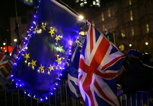 (AP Photo/Tim Ireland). Anti-Brexit, remain in the European Union supporters hold an EU and British union flag outside the Houses of Parliament in London, Wednesday, March 13, 2019. Britain's Parliament will vote later Wednesday on whether to rule out ...