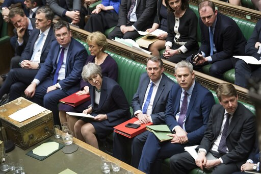 (Jessica Taylor/UK Parliament via AP). Britain's Prime Minister Theresa May, center front row, in the House of Commons, London, Wednesday March 13, 2019. In a tentative first step toward ending months of political deadlock, British lawmakers voted Wedn...