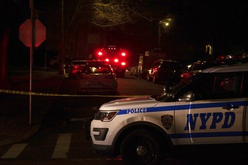 (Joseph Ostapiuk/Staten Island Advance via AP). New York Police Department and New York City Fire Department units respond to a report of shots fired Wednesday, March 13, 2019, in the Todt Hill section of the Staten Island borough of New York. A man sa...