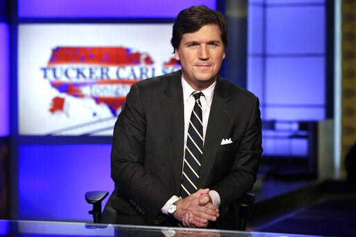 """(AP Photo/Richard Drew, File). FILE - In this March 2, 2017 file photo, Tucker Carlson, host of """"Tucker Carlson Tonight,"""" poses for photos in a Fox News Channel studio, in New York. The liberal advocacy group Media Matters for America this week release..."""