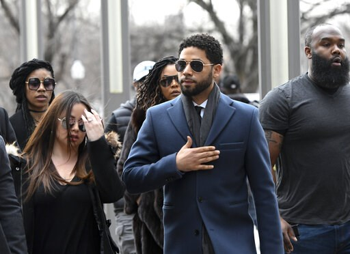 (AP Photo/Matt Marton). Empire actor Jussie Smollett, center, arrives at the Leighton Criminal Court Building for his hearing on Thursday, March 14, 2019, in Chicago.  Smollett is accused of lying to police about being the victim of a racist and homoph...