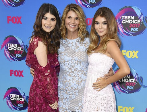 (Photo by Jordan Strauss/Invision/AP, File). FILE - In this Aug. 13, 2017 file photo, actress Lori Loughlin, center, poses with her daughters Bella, left, and Olivia Jade at the Teen Choice Awards in Los Angeles. The FBI says actress Lori Loughlin has ...