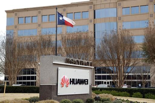 (AP Photo/Tony Gutierrez, File). FILE - This March 7, 2019 file photo shows the Huawei Technologies Ltd. business location in Plano, Texas. The No. 2 smartphone maker in the world will be arraigned at federal court in New York on Thursday, March 14. Pr...