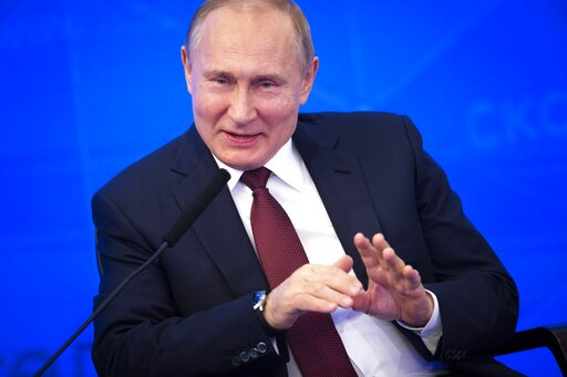 (AP Photo/Alexander Zemlianichenko). Russian President Vladimir Putin gestures while speaking at a meeting of the Russian Union of Industrialists and Entrepreneurs in Moscow, Russia, Thursday, March 14, 2019. Putin urged the business community to engag...