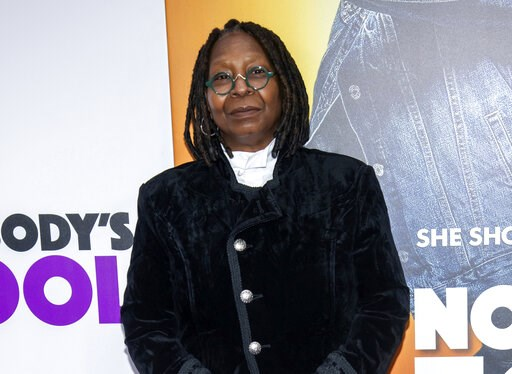 """(Photo by Charles Sykes/Invision/AP, File). FILE - In this Oct. 28, 2018 file photo, Whoopi Goldberg attends the world premiere of """"Nobody's Fool"""" in New York. Goldberg received a standing ovation from the audience and hugs from her castmates as she re..."""
