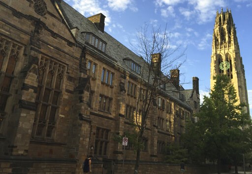 (AP Photo/Beth J. Harpaz, File). FILE - This Sept. 9, 2016 photo shows Harkness Tower on the campus of Yale University in New Haven, Conn. Dozens of people were charged Tuesday, March 12, 2019, in a scheme in which wealthy parents allegedly bribed coll...