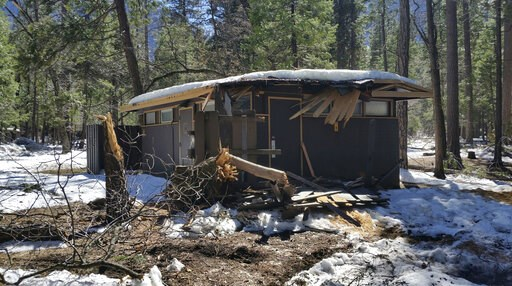 (NPS Photo via AP). In this photo released Wednesday, March 13, 2019, by the National Park Service, is a damaged building after the recent heavy snowpack in Yosemite National Park, Calif. The park announced that there will be late seasonal openings to ...