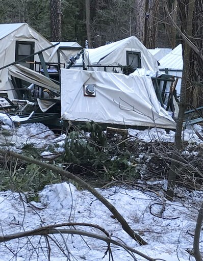 (NPS Photo via AP). In this photo released Wednesday, March 13, 2019, by the National Park Service, is a damaged tent cabin after the recent heavy snowpack in Yosemite National Park, Calif. The park announced that there will be late seasonal openings t...