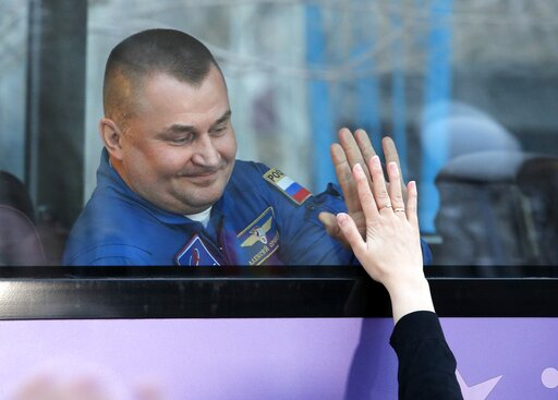 (AP Photo/Dmitri Lovetsky). Russian cosmonaut Alexey Ovchinin, a members of the main crew to the International Space Station (ISS), interacts with his relative from a bus prior to the launch of the Soyuz FG rocket at the Russian leased Baikonur cosmodr...