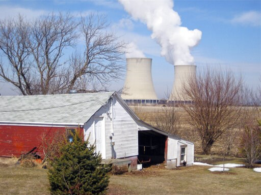 (AP Photo/Robert Ray, File). FILE - In this March 16, 2011, file photo, steam escapes from Exelon Corp.'s nuclear plant in Byron, Ill. The nuclear power industry is pushing the Nuclear Regulatory Commission to cut back on inspections at nuclear power p...