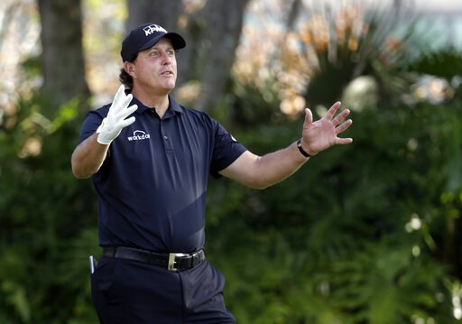 (AP Photo/Lynne Sladky). Phil Mickelson gestures as he waits his turn to tee off on the 13th hole during the first round of The Players Championship golf tournament Thursday, March 14, 2019, in Ponte Vedra Beach, Fla.