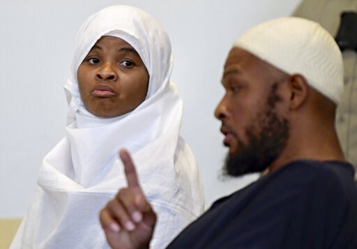 (Roberto E. Rosales/The Albuquerque Journal via AP, Pool, File). File - In this Aug. 13, 2018 file photo, defendants Hujrah Wahhaj, left, and Siraj Wahhaj talk during a break in court hearings in Taos, N.M. The Wahhajs were among several people arreste...