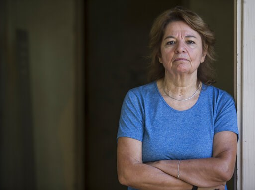 (AP Photo/Daniel Jayo). Graciela Garcia, who was turned into a sex slave when she was in her 20's by a former navy captain during Argentina's 1976-1983 dictatorship, poses for a portrait inside what was once the Naval Mechanics School, ESMA, where she ...