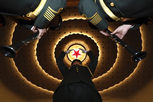 (AP Photo/Ng Han Guan). A military band conductor rehearses the band before the closing session of the National People's Congress in Beijing's Great Hall of the People on Friday, March 15, 2019.
