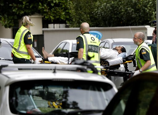 (AP Photo/Mark Baker). Ambulance staff take a man from outside a mosque in central Christchurch, New Zealand, Friday, March 15, 2019. A witness says many people have been killed in a mass shooting at a mosque in the New Zealand city of Christchurch.