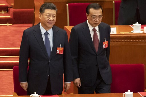 (AP Photo/Ng Han Guan). Chinese President Xi Jinping and Chinese Premier Li Keqiang arrive for the closing session of the National People's Congress in Beijing's Great hall of the People on Friday, March 15, 2019.