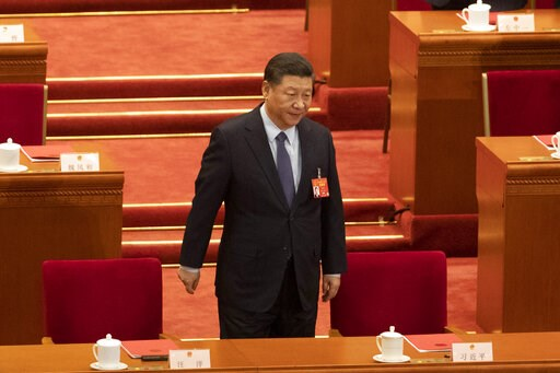 (AP Photo/Ng Han Guan). Chinese President Xi Jinping arrives for the closing session of the National People's Congress in Beijing's Great hall of the People on Friday, March 15, 2019.