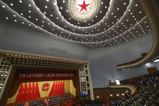 (AP Photo/Ng Han Guan). A military band plays the national anthem during the closing session of the National People's Congress in Beijing's Great Hall of the People on Friday, March 15, 2019.