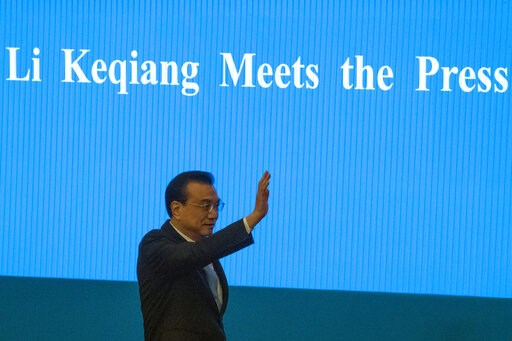 (AP Photo/Ng Han Guan). Chinese Premier Li Keqiang arrives for a press conference after the closing session of the National People's Congress in Beijing's Great Hall of the People on Friday, March 15, 2019.
