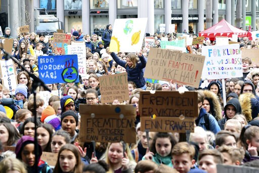(Marit Hommedal/ NTB scanpix via AP). Several thousand schoolchildren take part in a climate protest in Bergen, Norway, Thursday, March 14, 2019. Students in more than 1,000 cities worldwide are planning to skip class Friday in protest over their gover...