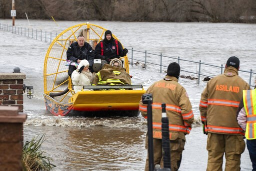 (Brendan Sullivan/Omaha World-Herald via AP). Mary Roncka and her husband Gene Roncka, right, accompanied by neighbor Kevin Mandina are evacuated as floodwaters rise Thursday, March 13, 2019, in Ashland, Neb. Evacuations forced by flooding have occurre...