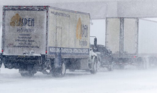 (AP Photo/David Zalubowski). Vehicles stack up on the eastbound lanes of Interstate 70 near Tower Road as a late winter storm packing hurricane-force winds and snow sweeps over the intermountain West Wednesday, March 13, 2019, in Aurora, Colo.