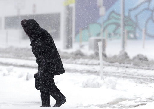 (AP Photo/David Zalubowski). A lone pedestrian struggles along Broadway as a late winter storm packing hurricane-force winds and snow sweeps over the intermountain West Wednesday, March 13, 2019, in Denver.