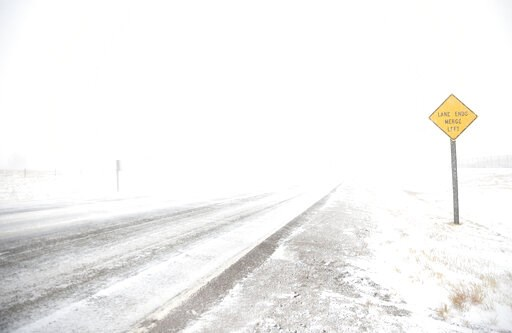 (Jacob Byk/The Wyoming Tribune Eagle via AP). White-out conditions along Happy Jack Road during a blizzard on Wednesday, March 13, 2019, in Cheyenne. White-out conditions closed I-80, I-25, and U.S. 85, effectively closing off the state capital from Ne...