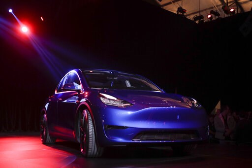 (AP Photo/Jae C. Hong). The Tesla Model Y is unveiled at Tesla's design studio Thursday, March 14, 2019, in Hawthorne, Calif. The Model Y may be Tesla's most important product yet as it attempts to expand into the mainstream and generate enough cash to...