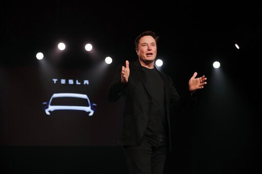 (AP Photo/Jae C. Hong). Tesla CEO Elon Musk speaks before unveiling the Model Y at Tesla's design studio Thursday, March 14, 2019, in Hawthorne, Calif. The Model Y may be Tesla's most important product yet as it attempts to expand into the mainstream a...