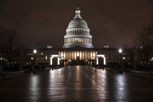 (AP Photo/J. Scott Applewhite). FILE - This March 21, 2018 file photo shows the Capitol in Washington before dawn. A Gallup poll in December 2018 asked respondents in the U.S. to rank 20 different occupations in terms of their ethical standards _ membe...