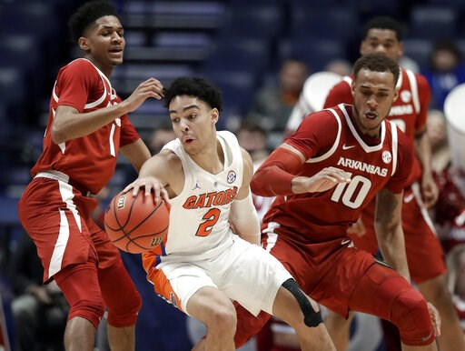 (AP Photo/Mark Humphrey). Florida guard Andrew Nembhard (2) moves away from Arkansas forward Daniel Gafford (10) in the first half of an NCAA college basketball game at the Southeastern Conference tournament Thursday, March 14, 2019, in Nashville, Tenn.