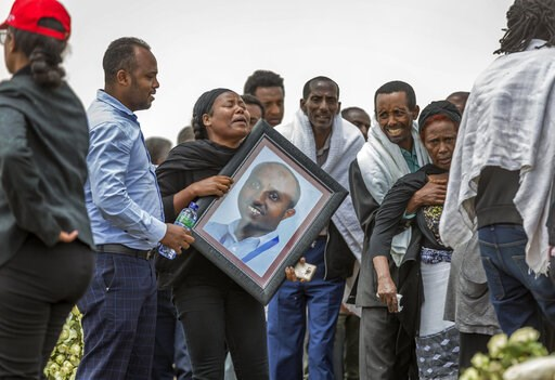 (AP Photo/Mulugeta Ayene). Ethiopian relatives of crash victims mourn and grieve at the scene where the Ethiopian Airlines Boeing 737 Max 8 crashed shortly after takeoff on Sunday killing all 157 on board, near Bishoftu, south-east of Addis Ababa, in E...