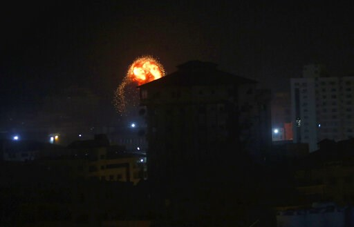 (AP Photo/Adel Hana). An explosion caused by Israeli airstrikes is seen on Gaza City, early Friday, Friday, March 15, 2019. Israeli warplanes attacked militant targets in the southern Gaza Strip early Friday in response to a rare rocket attack on the I...