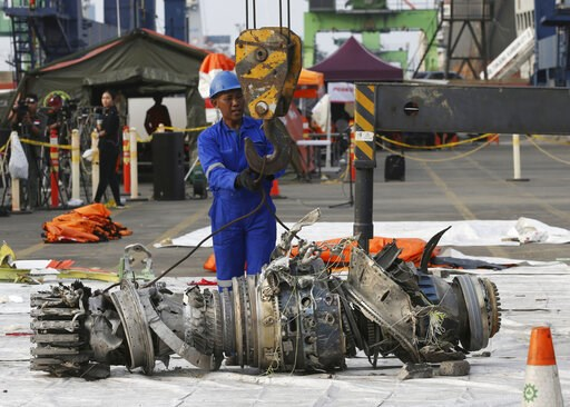 (AP Photo/Achmad Ibrahim, File). FILE - In this Nov. 4, 2018 file photo, officials move an engine recovered from the crashed Lion Air jet for further investigation in Jakarta, Indonesia. The brand new Boeing 737 MAX 8 jet plunged into the Java Sea just...