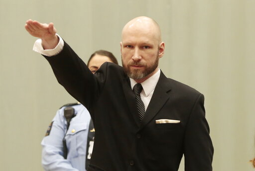 (Lise Aaserud/NTB Scanpix via AP, File). FILE - In this Tuesday, Jan. 10, 2017 file photo, Anders Behring Breivik raises his right hand at the start of his appeal case in Borgarting Court of Appeal at Telemark prison in Skien, Norway, Tuesday, Jan. 10,...